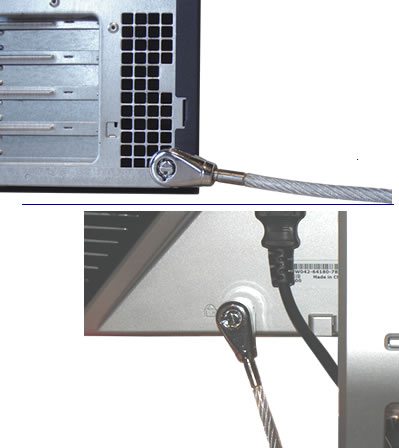 Guardian 820 lock with built in scissor clip attached to a computer and a monitor